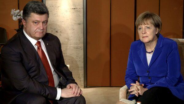 Президент Украины Петр Порошенко на встрече с канцлером Германии Ангелой Меркель. Архивное фото