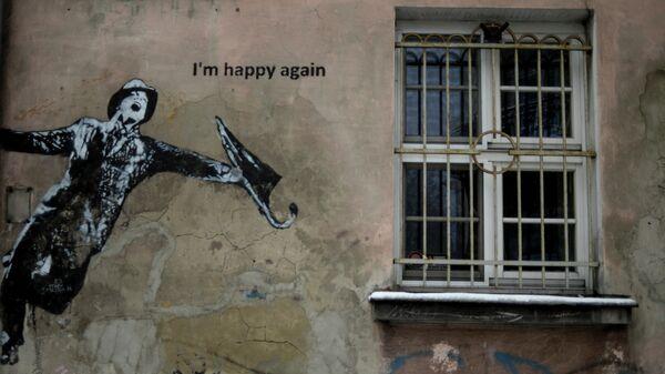 Граффити на стене дома в исторической части Кракова, Польша