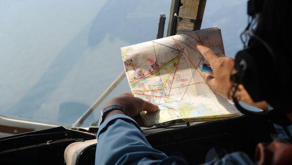 Член экипажа вьетнамского вертолета МИ-171, участвующего в поисках пропавшего малайзийского Боинга MH370. Архивное фото