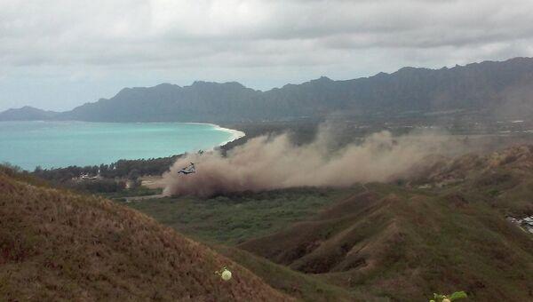 Конвертоплан MV-22 Osprey совершает жесткую посадку во время учебного полета на базе ВВС США Беллоуз на Гавайях