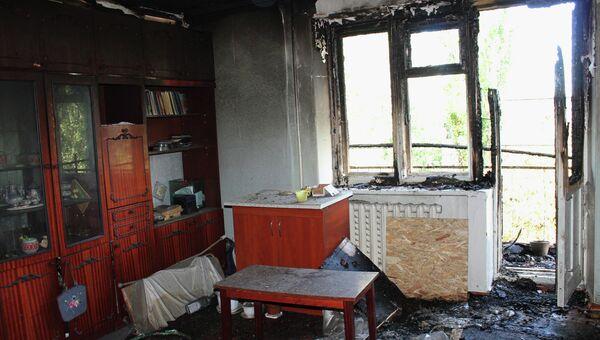 Разрушенная квартира в жилом многоквартирном доме, пострадавшем в результате обстрела украинскими силовиками города Донецка