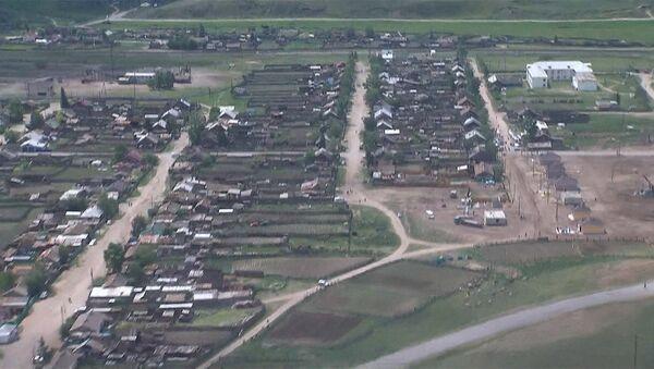 Путин с вертолета проинспектировал строительство жилья погорельцам Хакасии