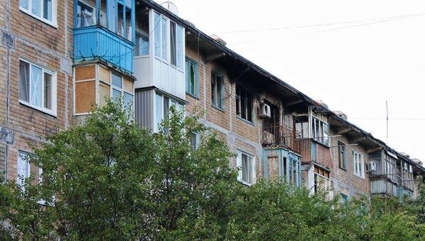 Дом, поврежденный в районе Донецка. Архивное фото
