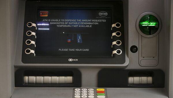 Банкомат, приостановивший обслуживание. Остров Санторини, Греция. Июнь 2015