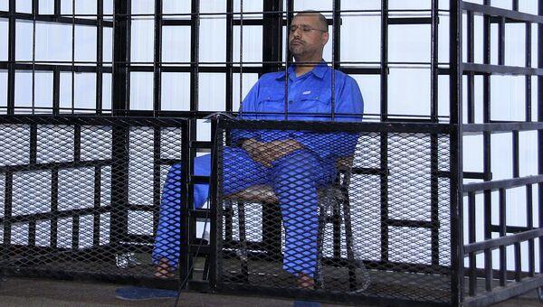 Сейф аль-Ислам Каддафи в зале суда в Зинтан, Ливия. 25 мая 2014
