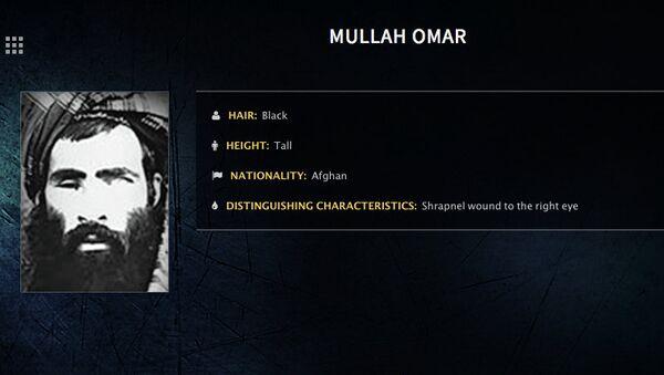 Плакат о розыске лидера группировки Талибана Муллы Омара, опубликованный ФБР США. Архивное фото
