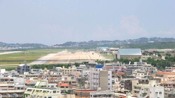 Вид на аэродром военной базы США Футэмма в городе Гинован