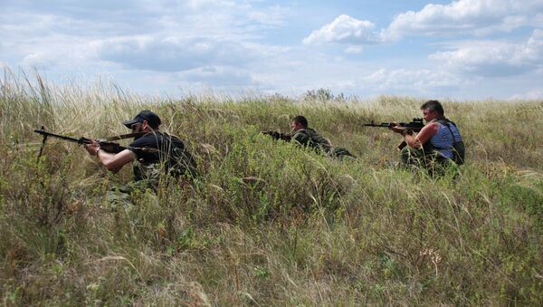 Бойцы 1-й Славянской бригады ополчения ДНР на позиции у линии соприкосновения с ВСУ. Архивное фото