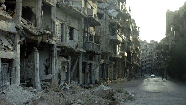Разрушенные здания, в результате боев в пригороде Дамаска, Сирия. Архивное фото