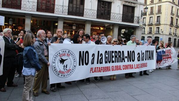 Митинг в Мадриде против войны в Сирии и в защиту беженцев, организованный Глобальной платформой против войн