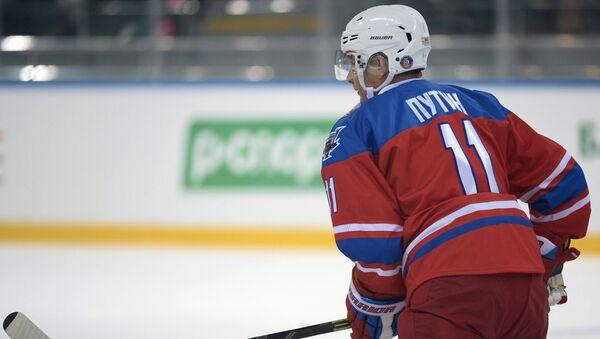 Президент РФ В. Путин принимает участие в хоккейном матче. Архивное фото