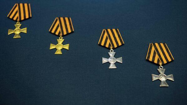 Знаки отличия военного ордена Святого Георгия I - IV степеней