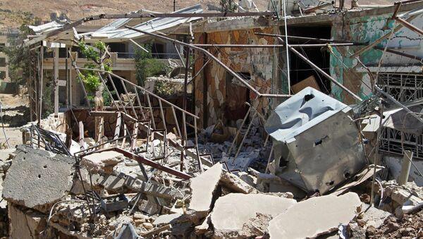 Разрушенные здания в сирийском городе Забадани к северо-западу от Дамаска. Архивное фото