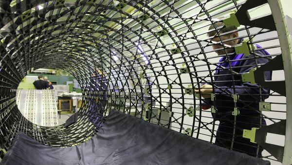 Изготовление центральной изогрибной конструкции космического аппарата. Архивное фото