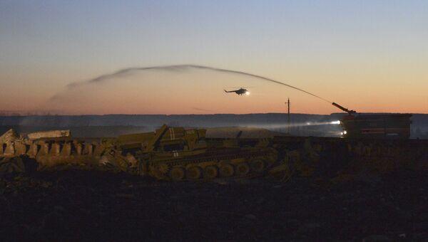 Ликвидация последствий пожара на складе ракетно-артиллерийского вооружения в городе Сватово Луганской области, Украина