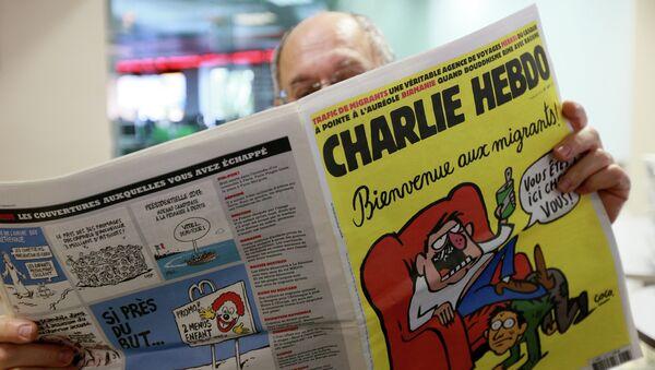 Издание Charlie Hebdo опубликовало карикатуры, героем которых стал утонувший сирийский мальчик Айлан Курди