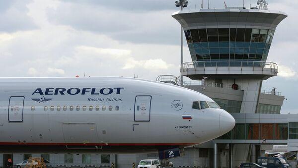 Самолет Boeing 777 авиакомпании Аэрофлот в международном аэропорту Шереметьево. Архивное фото