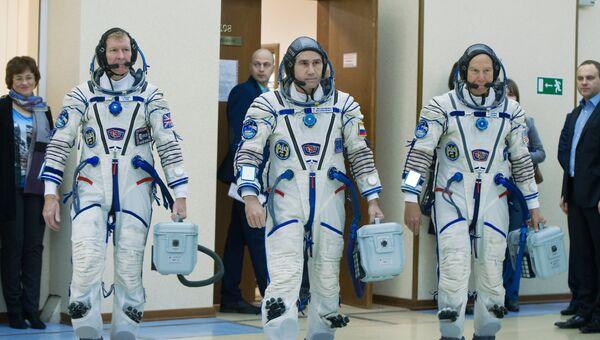 Участники основного экипажа Международной космической станции-46/47 астронавт ЕКА Тимоти Пик, космонавт Роскосмоса Юрий Маленченко, астронавт NASA Тимоти Копра. Архивное фото