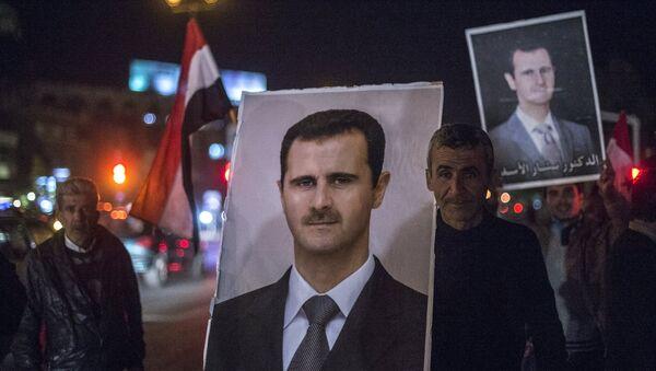 Плакат с изображением президента Сирии Башара Асада. Архивное фото