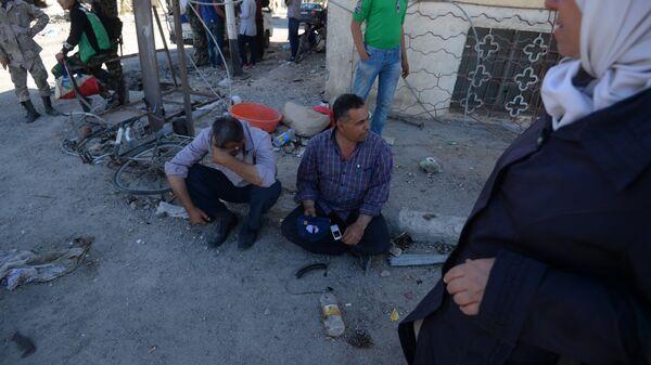 Жители Пальмиры, вернувшиеся в город после его освобождения от боевиков