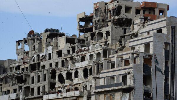 Вид на разрушенные дома в Хомсе. Архивное фото