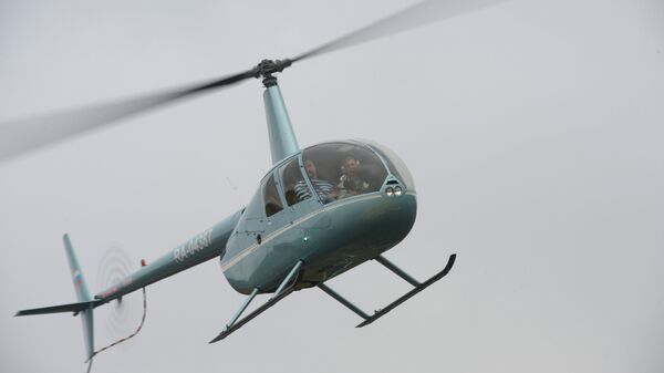 Вертолет Robinson 44. Архивное фото