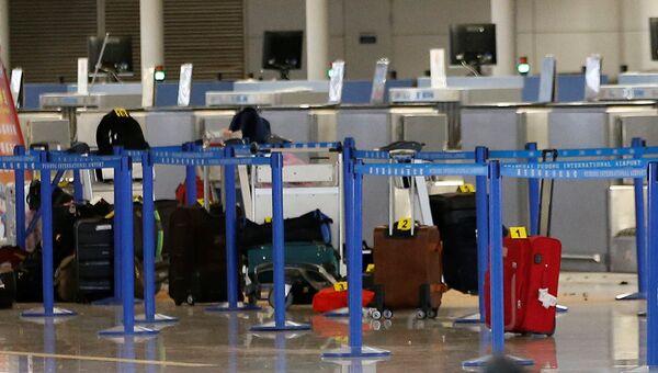 Багаж на месте взрыва в аэропорту Пудун в Шанхае, 12 июня 2016