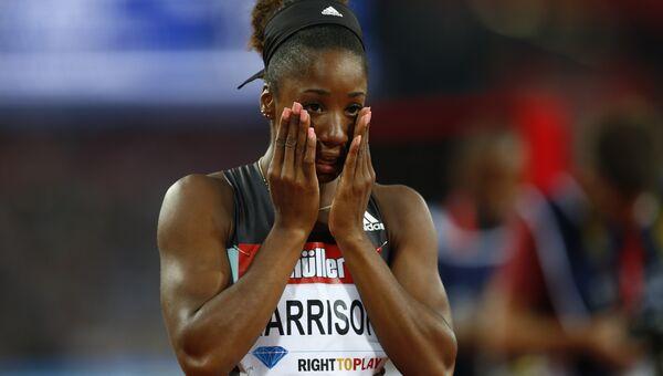 Легкоатлетка Кендра Харрисон после финиша в беге на сто метров с барьерами