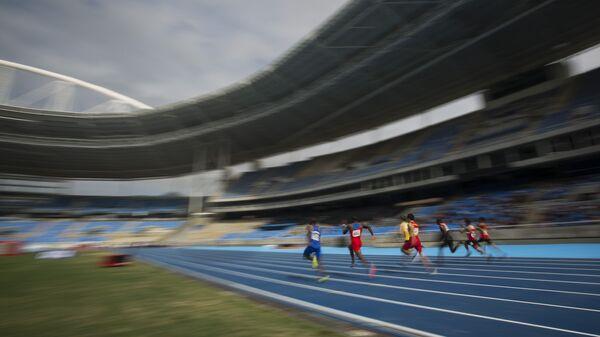 Предолимпийский тестовый забег на 100-метровую дистанцию на Олимпийском стадионе имени Жоао Авеланжа в Рио-де-Жанейро, Бразилия. Архивное фото
