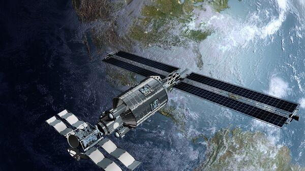 Космический спутник во время облета Земли