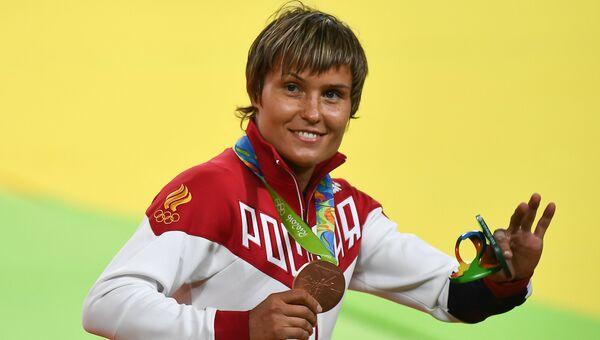 Наталья Кузютина, завоевавшая бронзовую медаль в женских соревнованиях по дзюдо в весовой категории до 52 кг на XXXI летних Олимпийских играх
