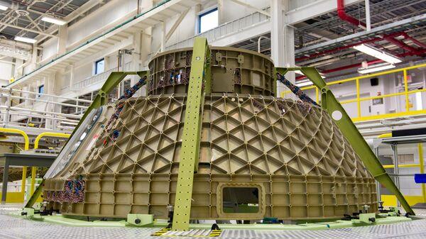 Пилотируемый транспортный космический корабль CST 100 Starliner, разрабатываемый компанией Boeing. Архивное фото