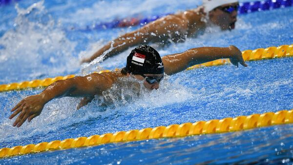 Сингапурский пловец Джозеф Скулинг в финальном заплыве на 100 м баттерфляем на XXXI летних Олимпийских играх