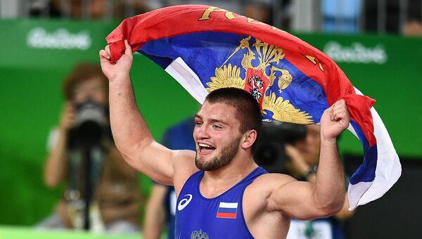 Давит Чакветадзе (Россия) радуется победе в финале соревнований по греко-римской борьбе на XXXI летних Олимпийских играх