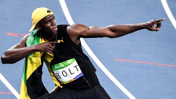 Усэйн Болт после финиша в финальном забеге на 100 м. Архивное фото