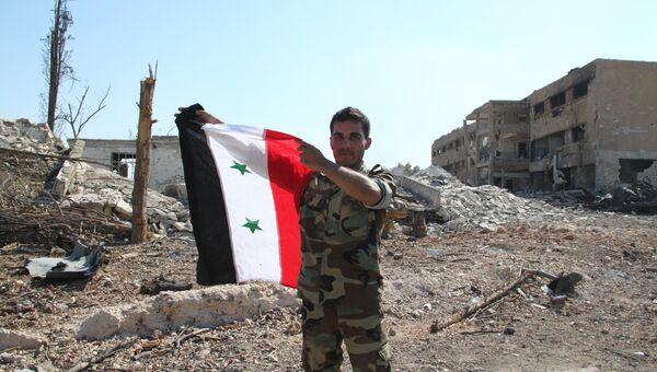 Сирийский солдат в Алеппо после освобождения военных училищ. Архивное фото