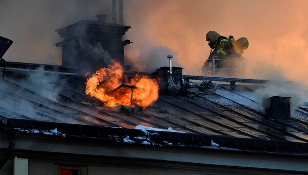 Пожарные во время пожара в Королевской академии искусств в Стокгольме. 21 сентября 2016