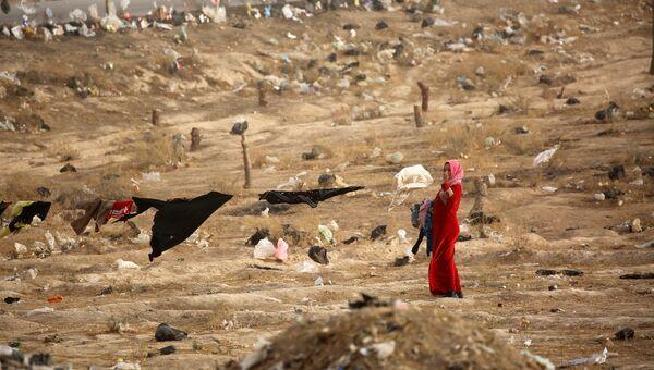 Женщина, покинувшая иракский Мосул во время операции против ИГ. Архивное фото