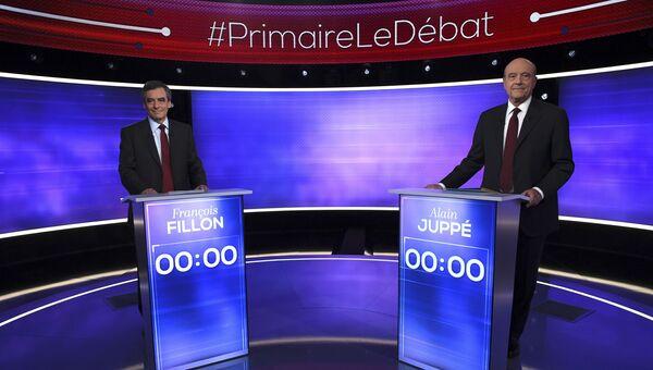 Франсуа Фийон и Ален Жюппе во время телевизионных дебатов в Париже