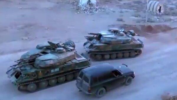 Боевики сдают военную технику сирийским правительственным войскам
