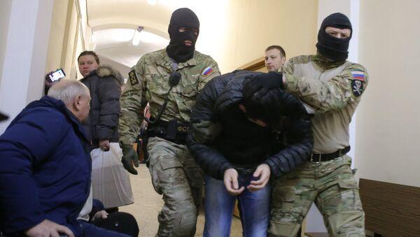 Подозреваемый в подготовке терактов в Москве Тамерлан Сычоев в Мещанском суде