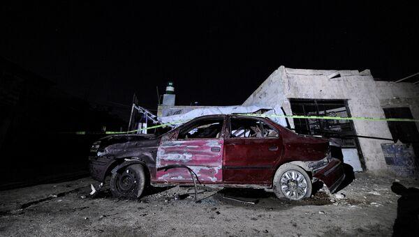 На месте взрыва в районе Кафрсусе в Дамаске, Сирия. 12 января 2017