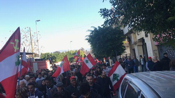 Сторонники компартии Ливана проводят мирную демонстрацию в центре Бейрута