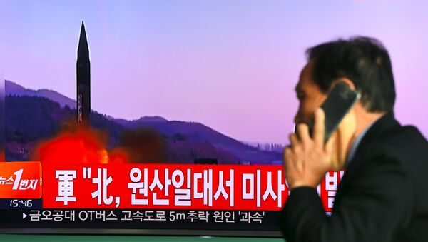 Телевизионный выпуск новостей о запуске северокорейской ракеты. Архивное фото