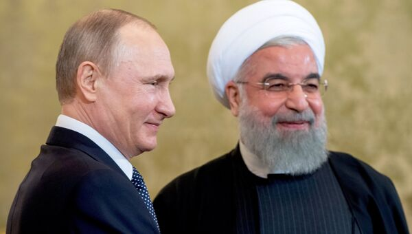 Президент РФ Владимир Путин и президент Исламской Республики Иран Хасан Рухани во время встречи в Москве. 28 марта 2017