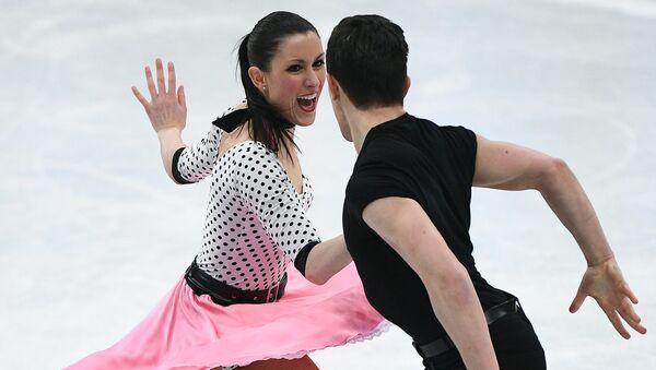 Шарлен Гиньяр и Марко Фаббри выступают в короткой программе танцев на льду на ЧМ по фигурному катанию в Хельсинки