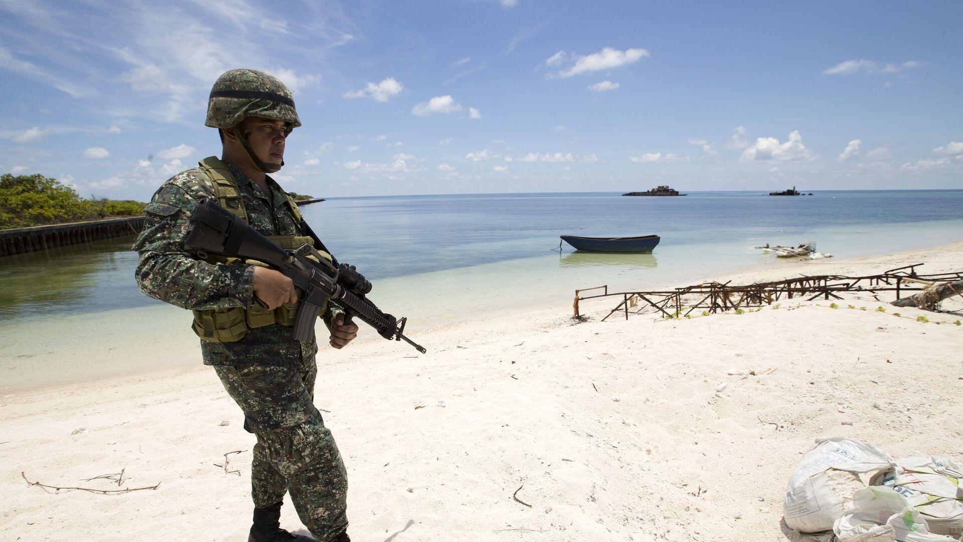 Филиппинский военный на на острове Титу в Южно-Китайском море - РИА Новости, 1920, 04.05.2021