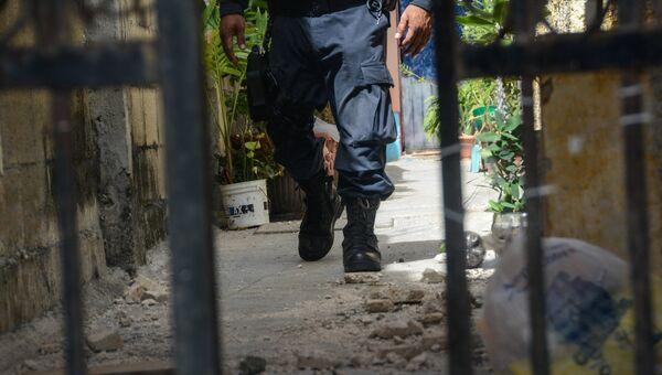 Полицейский на месте нападения на россиянина в Канкуне