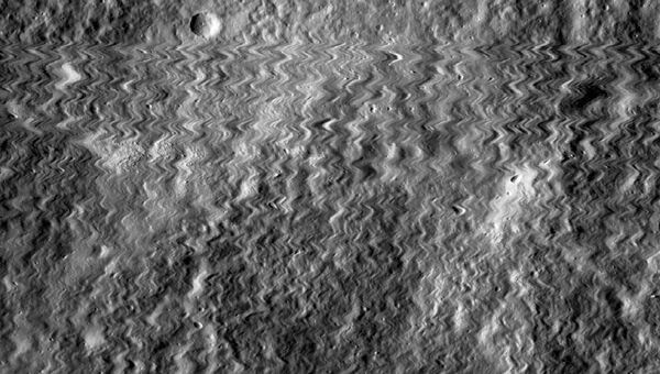 Снимок, полученный камерой LROC во время столкновения с микро-астероидом