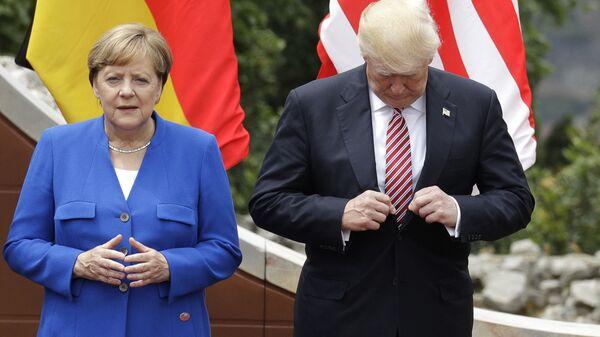 Ангела Меркель и Дональд Трамп во время саммита G7 в Таормине, Италия. 26 мая 2017